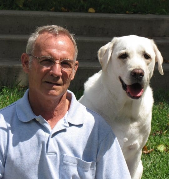 man and dog smiling together