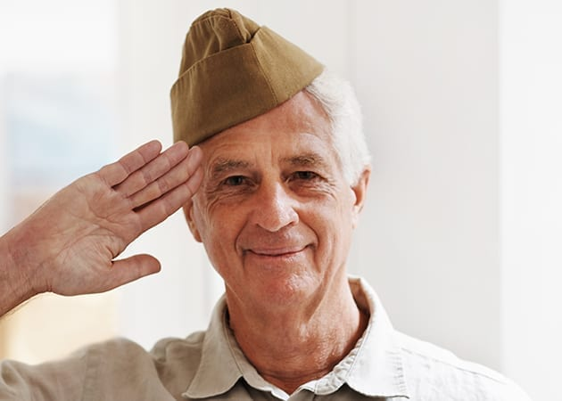 veteran saluting in bright light hosparus