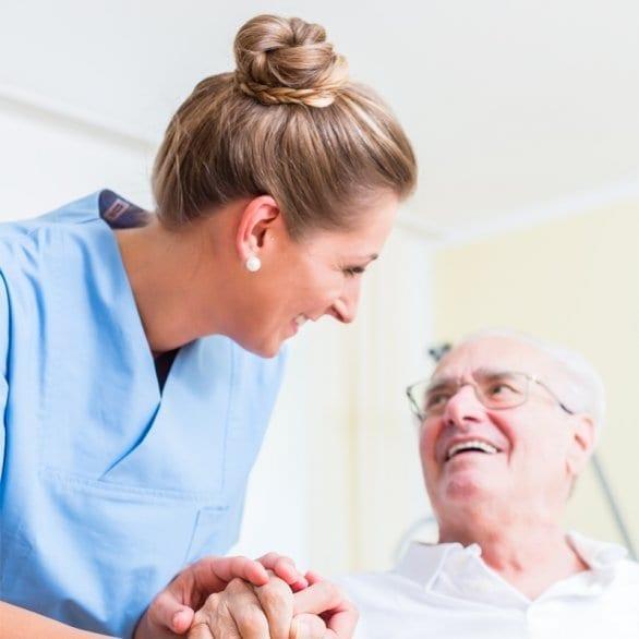 woman caregiver talking to man