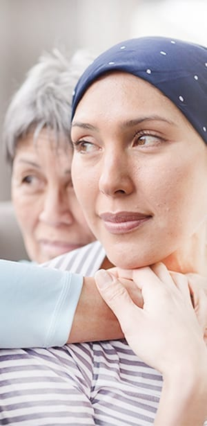 woman looking over her should palliative care